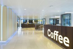 Heyligers d+p completed the interior design for the whole 27.000m2 head office for NUON (power company) in Amsterdam, The Netherlands. Coffee bar. www.h-dp.nl