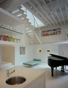 12 Loft Mezzanines: San Antonio-based Poteet Architects and Austin-based FAB Architecture designed the Capps Loft project, located in the King William District of San Antonio. Originally, an industrial warehouse complex, the interior was painted a minimalist white to showcase the owner's collection of contemporary artwork.