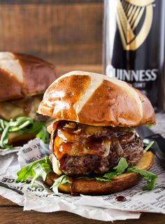 These blue cheese burgers are brushed with a homemade whiskey glaze, topped with Irish cheese, and smothered in Guinness caramelized onions!