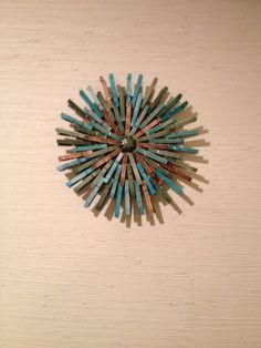 Clothespins dyed and sanded and glued into a starburst.