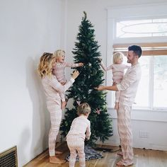 Couldn't wait one more second to put up the Christmas tree and surprise our boys with our matching Jammies! And I'm going to make sure this family tradition sticks around. So excited for this Christmas season! Cute Family, Baby Family, Family Goals, Decoration Christmas, Noel Christmas, Family Christmas, Christmas Photos, Merry And Bright, Christmas Traditions