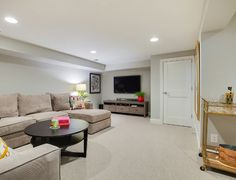 This is a great neutral basement paint color that I often recommend to my clients; Benjamin Moore 1465 Nimbus.