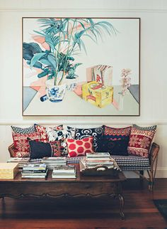 Living room mismatched cushions vintage cane interesting coffee table Anna Spiro couch_vertical