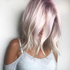 Icy platinum white blonde with a pale lavender purple shadow root by Aveda Artist Sarah Sibley.