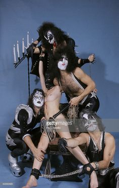 Photo of Ace FREHLEY and KISS and Peter CRISS and Gene SIMMONS and Paul STANLEY; L-R: Ace Frehley, model, Gene Simmons (back, top), Paul Stanley, Peter Criss - posed, studio, group shot