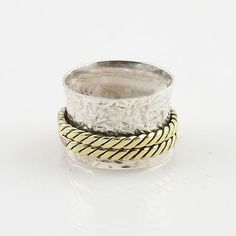 """Solid Sterling Silver and Bronze Spinner Ring DETAILS: * Size 7 * 5.4 g total weight * SOLID .925 Sterling Silver * Stamped .925 * Measures approximately 1/2"""" wide Spinner Rings are also called Tibeta"""