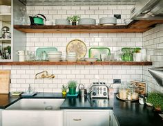 subway, reclaimed wood, brass wall mount faucet, apron sink, soapstone countertops, white lower cabinets. Yes.
