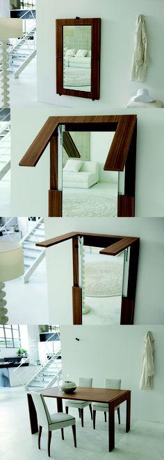 Specchio da parete trasformabile in tavolo con movimento di gancio-sgancio brevettato. design: G. Borgonovo