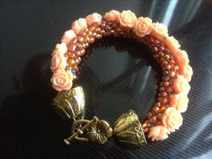 Cute little coral roses, kumihimo Cuff.