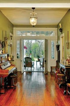 Louisiana plantation time capsule home restored. The double front door, bordered by the original transom and sidelights, helps to usher cooling breezes into the foyer. Unusual Homes, French House, Home, House Inspiration, Louisiana Homes, Louisiana Decor, House, Antebellum Homes, Old House Dreams