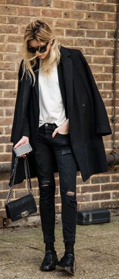 Chain Trend: Camille Charriere with her Boy bag from Chanel. It is the chain and the quilted pattern that does it for us