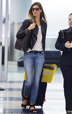 Stunning supermodel: #Gisele Bundchen arrived at JFK Airport in New York City wearing a chic leather jacket ,mating black #shoes and bag.. casual attire #fashion