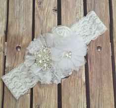 This beautiful all white headband features three different style of flowers clustered together on a 1.5 inch stretch lace. Finished with rhinestones and pearls this headband is the perfect finishing touch to any outfit