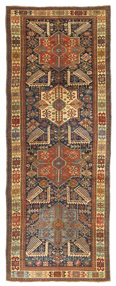 An Akstafa long rug, East Caucasus approximately 10ft. 10in. by 4ft. 1in. (3.30 by 1.24m.) circa 1890