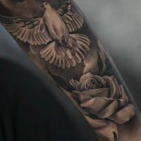 40 Creative Dove Tattoo Designs And Symbolic Meaning Peace Harmony inside The Most Incredible and also Stunning Dove Tattoo with regard to Tattoo Design Dove And Rose Tattoo, Rose Tattoos For Men, Dove Tattoos, Chest Tattoos For Women, Arm Tattoos For Guys, Men Tattoos, Small Tattoos, Rosen Tattoo Mann, Religous Tattoo