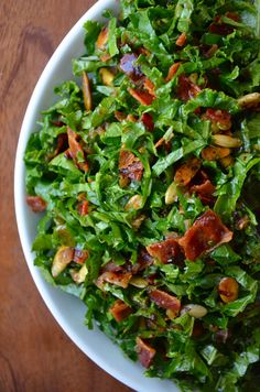 Raw Kale Salad with Warm Bacon Vinaigrette Yield: 4 - 6 servingsPrep Time: 10 minCook Time: 10 min Ingredients: 2 pounds kale, washed and thoroughly dried 1/3 cup toasted nuts (such as walnuts, pecans or pepitas) 6 slices bacon 2 Tablespoons minced shallots 1/2 cup apple cider vinegar 2 teaspoons packed light brown sugar 1 teaspoon Dijon mustard