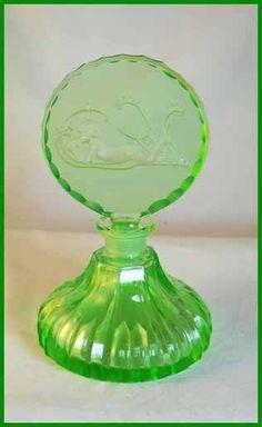 Green figural czech perfume bottle (see http://sherrysantiquebottles.homestead.com/czech_page.html)