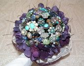 Peacock inspired wedding brooch bouquet with purple green and blue