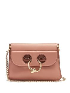 J.W.Anderson's cult Pierce bag comes in feminine pastel-pink leather for the new season – the perfect foil to the punk-inspired gold-tone metal barbell ring that's taken from the designer's menswear collection. Though mini, it has an expandable accordion silhouette for added space. Carry it across the body of a contemporary day dress.