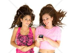 happy teenage girls listening to music. - portrait of happy teenage girls listening to music over white background.