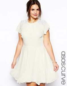 Sweet, yet embellished, the ASOS CURVE Embellished Dress With Angel Sleeve is a delightful option for a vow renewal dress.