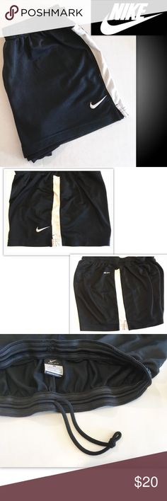 NIKE DRY Fit running Shorts Women's Size L NIKE DRY Fit running bottoms. Previously owned and lightly used with NO holes or stains.Feel free to bundle with my other items. Thank you for looking. * Nike Fit Dry Shorts * Womens Size Large * Black and White in color * Great athletic running style * Good condition Nike Shorts