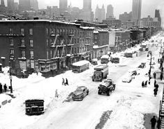 A city street becomes an icy tundra as cars try (unsuccessfully) to plough through the snow along Second Avenue in December, 1947.