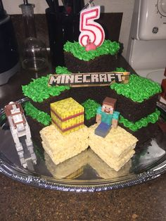 Diy Minecraft cake 3 easy ingredients 2 chocolate cake box 2 bottles of Betty Crocker green cupcake icing and 4 rice krispies and there you have it