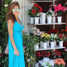 Fresh blooms and Aegean blue! Both the maxi dress and sunglasses are both from TJ's!   cc: @achicvoyage