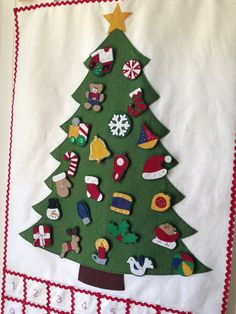 Advent Calendar. Felt ornaments attach to the tree with snaps. The kids will love this!