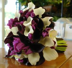 Love the dark calla litlies with the mix of lighter purple flowers and cream lillies