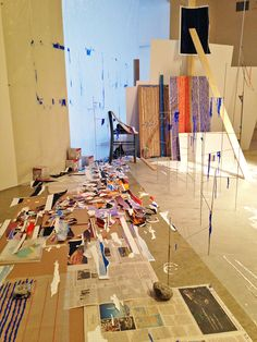 """Sarah Sze, """"Second Studio (Fragment Series)"""" (detail) (2015), acrylic paint, archival prints, stainless steel, wood, chair, metal chain, stone, plastic, plant, foamcore, newspaper, chipboard,"""