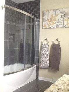 Love The Dark Grey Floor And Shower Tile. Curved Tub And Doors Add Elbow  Space.