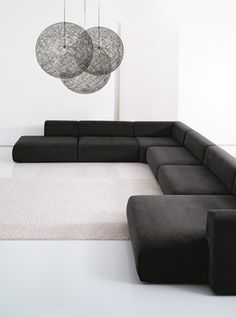 More studio inspiration blog off center lighting w/ a xlong couch creates some interest.  not this couch or light.