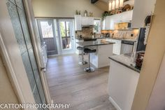 The kitchen of this beautiful Home features Lauzon Flooring Fifth Avenue Wire…