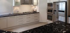 Cosmic Black Granite Benchtops with White Cupboard Fronts