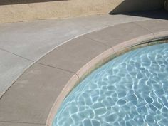 Freeform Pool And Spa With Poured In Place Colored Concrete Coping And