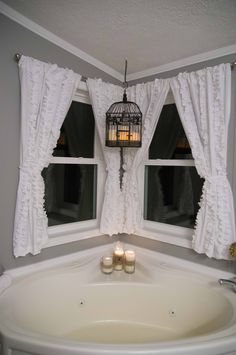 Love the bird cage with candles from the ceiling! The curtains are adorable