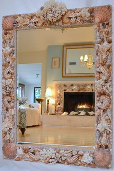Made this custom seashell mirror with coral, nautilus shells and lots of natural and polished seashells in brown tones for a client in New York. www.elegantshells.com