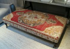 Antique rug covered Ottoman!-Such a great idea and a great way to enjoy this lovely rug without walking on it!! DG