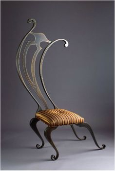 Looks like it came out of the Beauty and the Beast movie :)Whimsical Furniture & Conversation Pieces! Creative Chair by John Suttman.