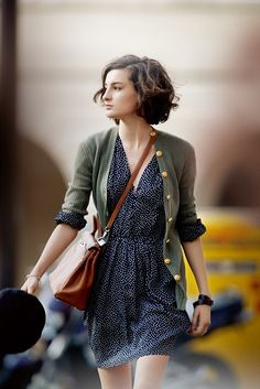 Love her style. Perfect print, longsleeve dress, layered with a cardigan, and leather accessories. Just my style.
