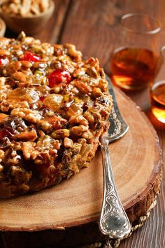 NYT Cooking: The ridicule that most fruitcakes face has everything to do with bad recipes, which skimp on fruit and load on the batter. In a good fruitcake the batter should barely be perceptible, acting merely as adhesive to bind the fruit and nuts. Broken down into its parts, a good fruitcake contains ingredients that most people love: plump dates, candied cherries, almond extract,%2...