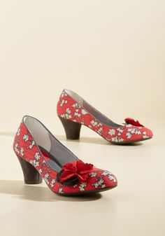 With these bright pink mid-heels by Ruby Shoo in your possession, you're good to go on fancy kicks for, well, forever! A textile pair with black-and-white floral uppers, dark grey trim, and scalloped rosettes, this vintage-inspired footwear is as fab as they come.