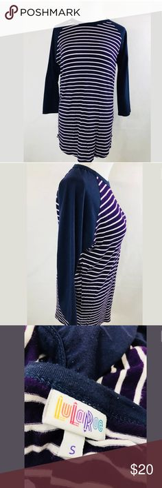 "LuLaRoe Navy Blue Sleeve Purple White Stripe Randy LuLaRoe Navy Blue Sleeves Purple White Striped Randy Baseball Tee Size S Small. Super stretch!  96% Spun Polyester 4% Spandex  Length (Shoulder to Hem) - 28"" Armpit to Armpit - 21"" **All measurements are approximate** LuLaRoe Tops Tees - Short Sleeve"