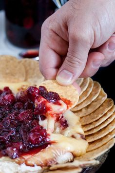 Baked brie is an impressive, yet easy holiday appetizer! This recipe tops the baked brie with a fresh cranberry balsamic compote that keeps you coming back for bite after bite! Thanksgiving Appetizers, Holiday Appetizers, Holiday Recipes, Simple Appetizers, Holiday Meals, Thanksgiving Holiday, Party Recipes, Dinner Recipes, Brie Appetizer