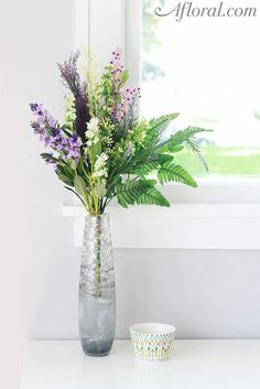This beautiful spring silk flower bundle features lavender, white forget-me-nots, purple accent flowers, and green leaf accents. Perfect to drop in a vase!