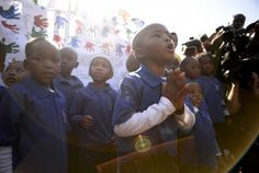 PHOTOS: People gather to support former South African president Nelson Mandela