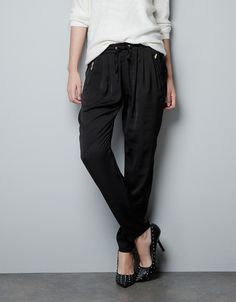 ELASTICATED TROUSERS WITH ZIPS