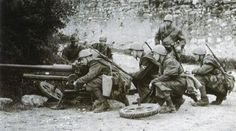 Italiane SS Legionarios with anti tank weapon. Wearing m29 camo ground sheets and M33 helmets. The Italian SS sleeve eagle can be seen on one of the Legionarios sleeve.